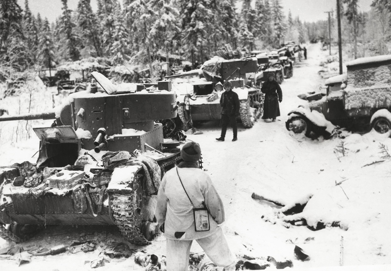 Finnish soldiers, dressed in white, would often interrupt the long columns of Soviet soldiers by stopping and blowing up tanks.