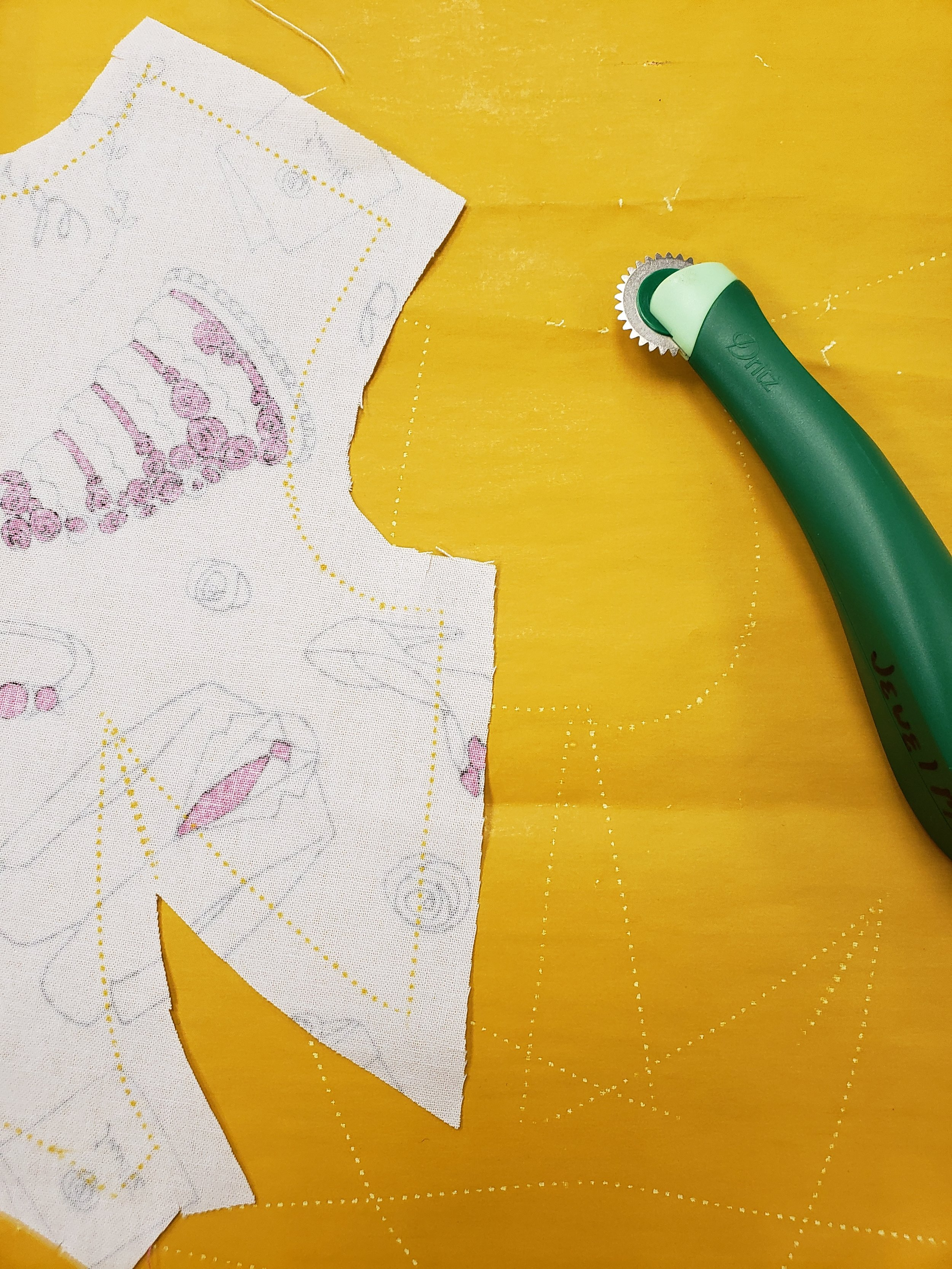 Using a tracing wheel to mark my darts and seam lines for the first time!