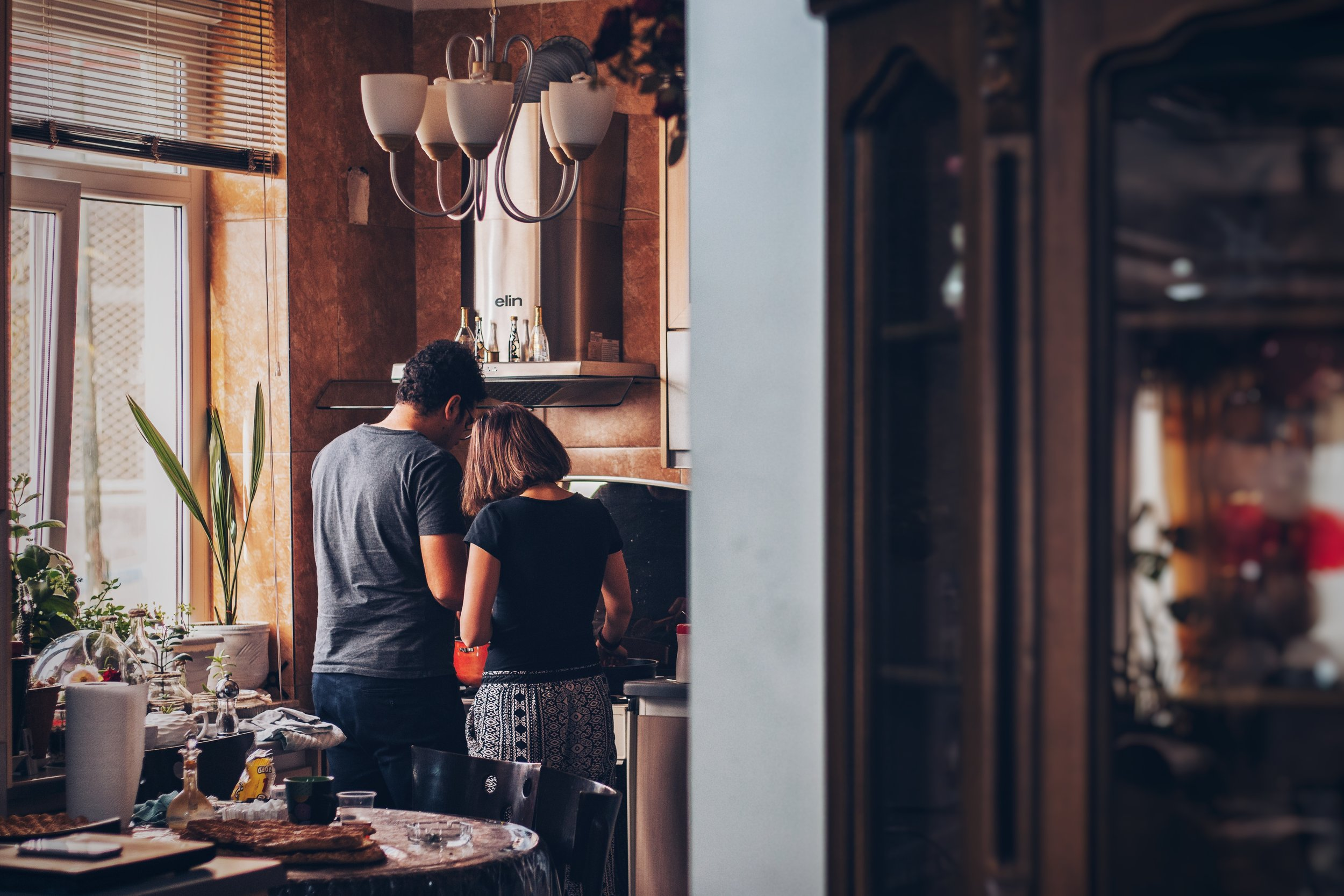 Couple cooking at home