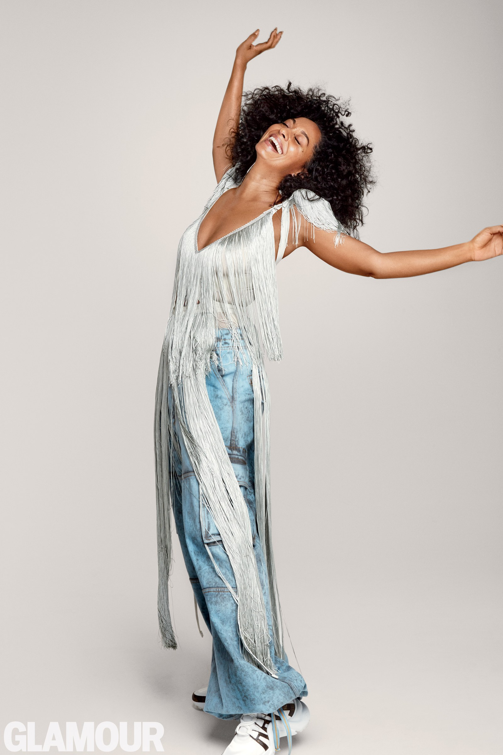 Dress by Nina Ricci. - Pants by Palm Angels. Earrings by Jennifer Fisher x La Ligne. Sneakers by Louis Vuitton