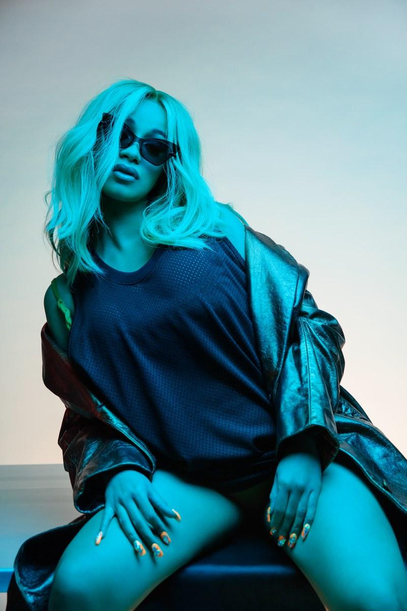 Cardi B. GQ May 2018 - Tank top by Fear of God / Coat by Helmut Lang / Sunglasses by Karen Walker