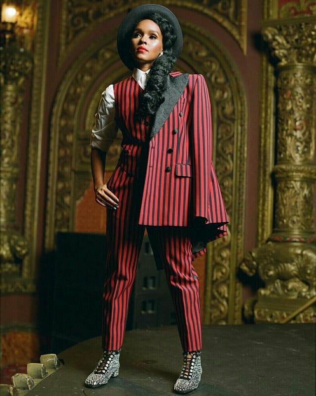 JANELLE'S WEARING - Dolce & Gabbana full suit; Christian Dior hat; Christian Dior boots; Bulgari earring.