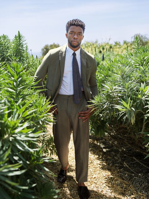 CHADWICK BOSEMAN - Suit, shirt, and tie by Emporio Armani; shoes by Pierre Hardy.