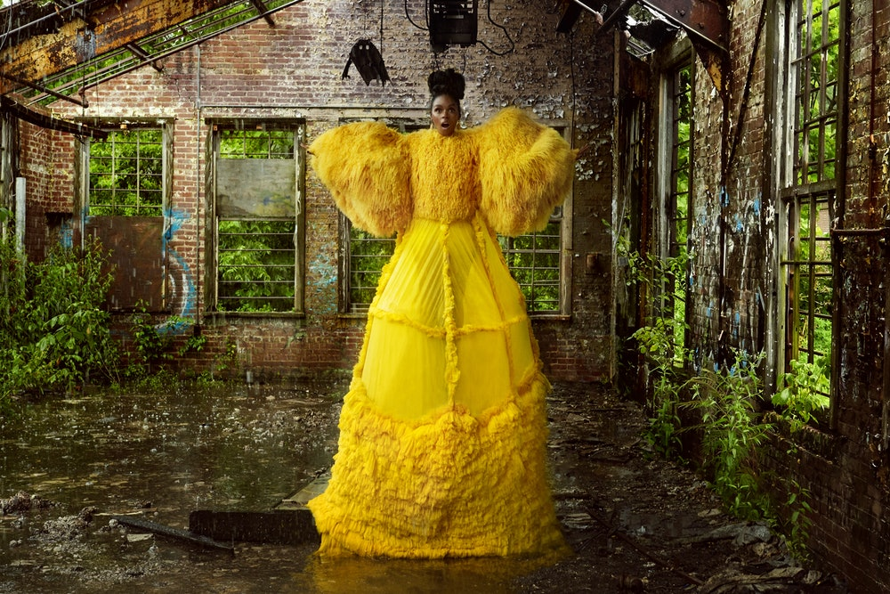 - Gown: David Ferreira. Earrings: Versace.