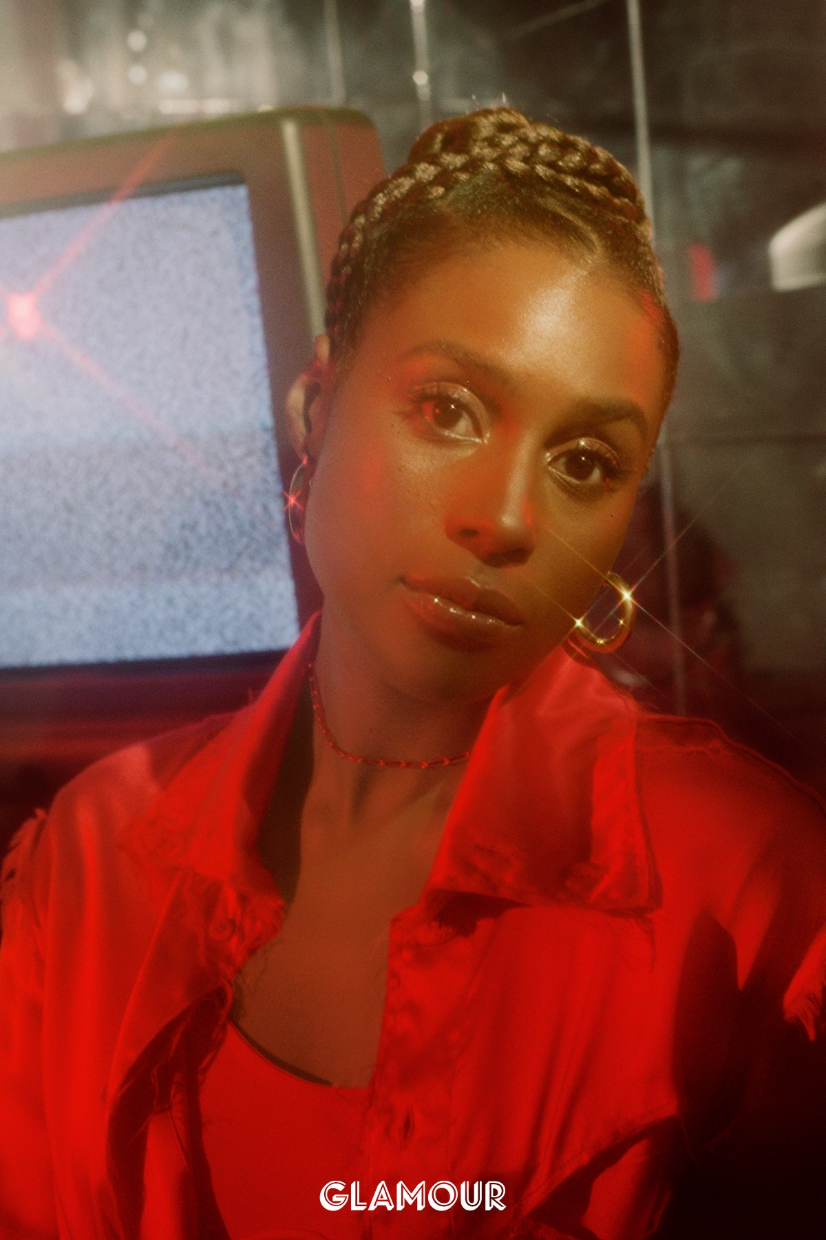- Telfar blouse, $550. H&M bodysuit, $50. Ventrone Chronicles hoops, $50.