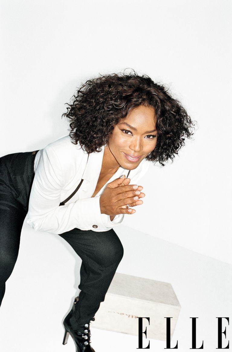 Angela is wearing Jumpsuit, Louis Vuitton, 800-929-DIOR. Hoop earrings by Chopard, 800-CHOPARD.
