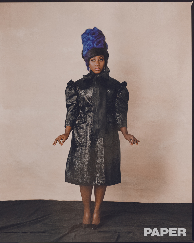- Coat: Simone Rocha, Top: Prada, Earrings: Judy Geib, Shoes: Jimmy Choo