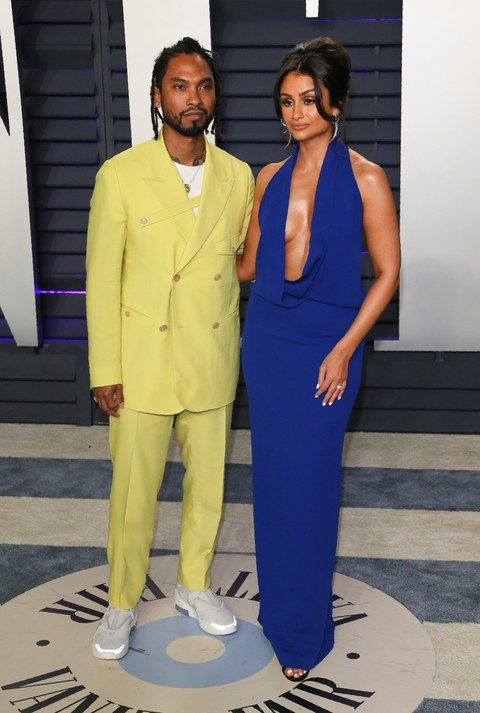 VANITY FAIR OSCARS AFTER PARTY RED CARPET MIGUEL AND WIFE.jpg