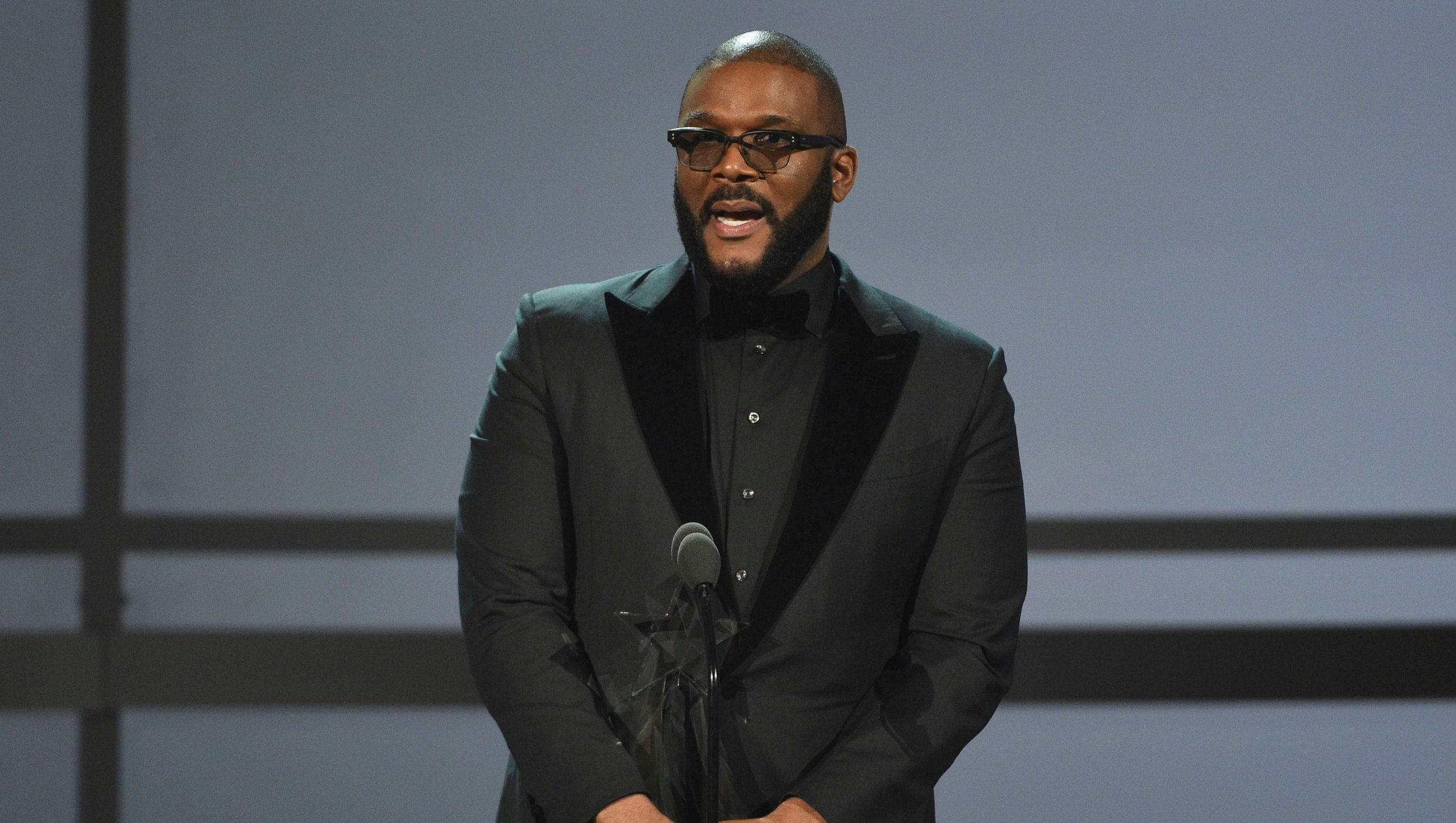 "- BET honored Tyler Perry with the Icon Award. Taraji P. Henson presented Tyler with the award after she described that he was the only filmmaker to pay her for her worth. Tyler's speech was so compelling that he had the crowd on their feet. Here is a brief snippet of his speech: ""And, I want you to hear this, which meant that there was Confederate soldiers on that base, plotting and planning on how to keep 3.9 million negroes enslaved. Now that land is owned by one negro.""…… ""While everybody was fighting for a seat at the table talking about #OscarsSoWhite, #OscarsSoWhite, I said, 'Y'all go ahead and do that,'"" he said. ""But while you're fighting for a seat at the table, I'll be down in Atlanta building my own. Because what I know for sure is that if I could just build this table, God will prepare it for me in the presence of my enemies."""