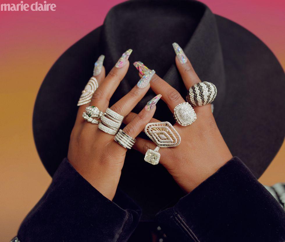 - Dolce & Gabbana jacket; Jacob & Co. pavé diamond cocktail ring (on left finger) and zebra dome ring; Bulgari serpent ring (on left finger); Bulgari white-gold-and-diamond ring (on left pinky); All other rings Elliott's own.