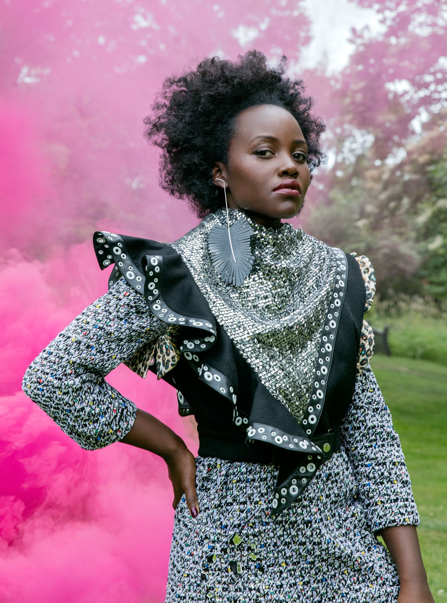 - Lupita is in clothing & jewelry by Louis Vuitton