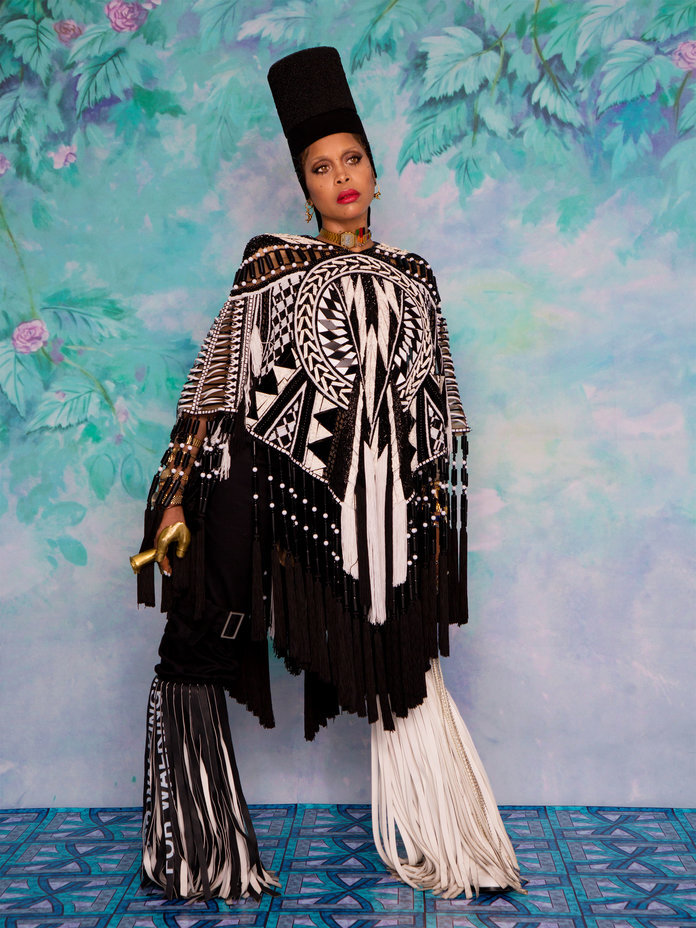 - Badu in a Balmain poncho; Palm Angels pants; and Dior earrings. From Badu's collection: a House of Flora with Neil Moodie headpiece; a Custom choker by Chris Habana; a Chris Habana pearl handlet; Angostura rings and finger casts; studs, watches, and bracelets; and Off-White c/o Virgil Abloh boots.