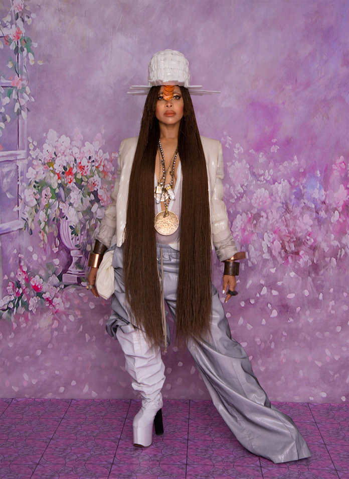 - Badu in a Rick Owens blazer, T-shirt, and pants and a Jo Miller hat. From Badu's collection: a L'Enchanteur hair clip; Parts of Four talismans (crystals), bracelets, and rings; amulets and talismans; and Micol Ragni boots.