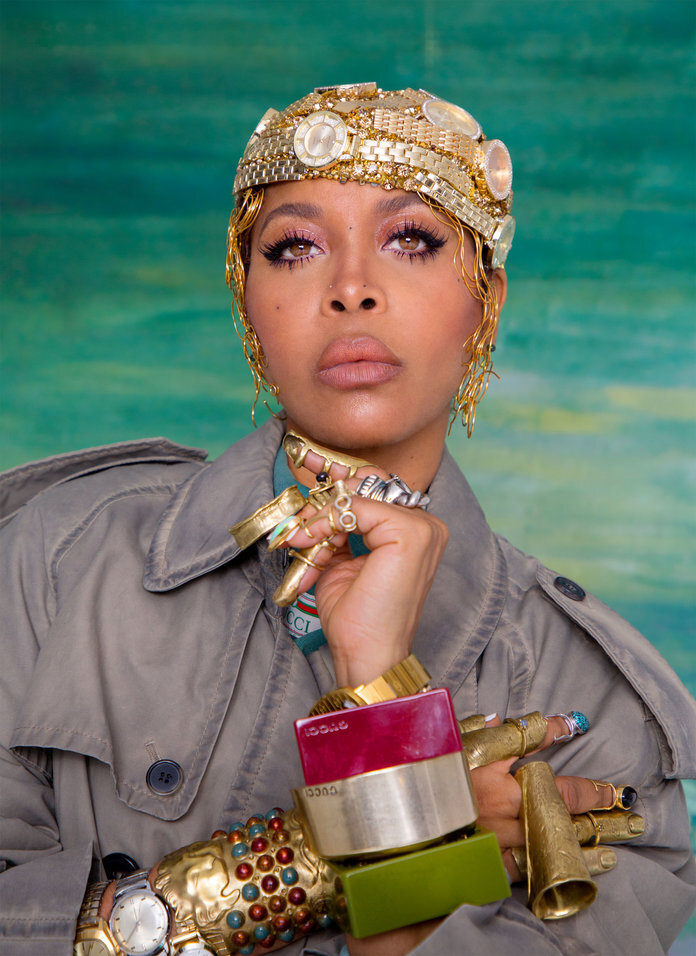 - Badu in a Maison Margiela trenchcoat; a Gucci jacket; a Christian Cowan wig cap; and Gucci cuffs. From Badu's collection: L'Enchanteur hair clips; Angostura rings and finger casts; Into Into nail rings; and watches and bracelets.
