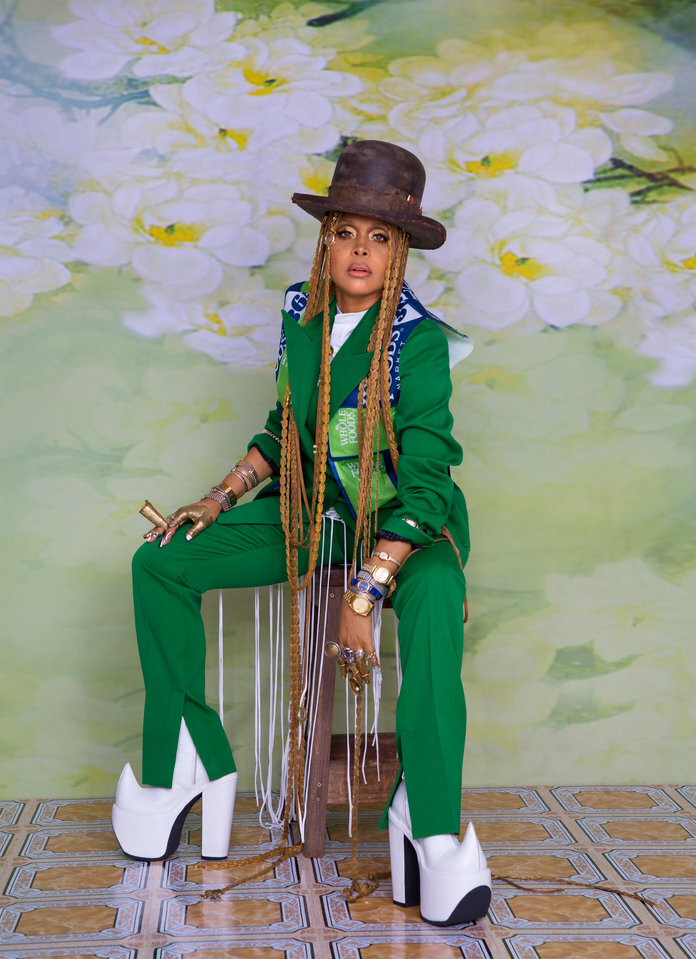 - Badu in a Nicole McLaughlin vest; Givenchy jacket and trousers; and an Off-White c/o Virgil Abloh dress. From Badu's collection: a Gunner Foxx hat; a L'Enchanteur headpiece; Angostura rings and finger casts; Into Into nail rings; a shirt, watches, and bracelets; and Robert Wun boots.