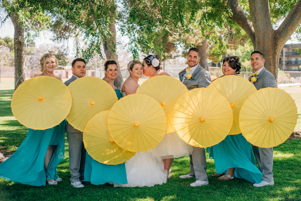wedding party with yellow parasols