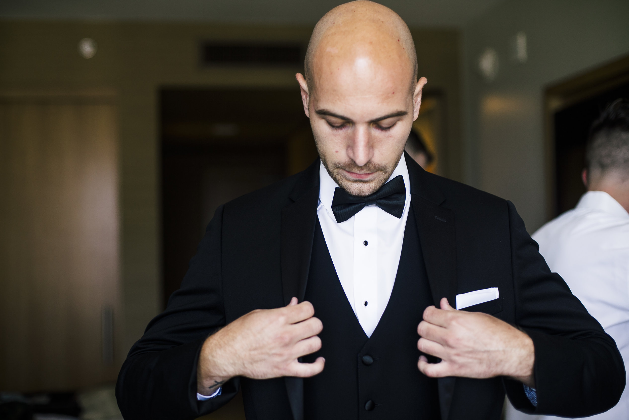 dapper groom anticipating wedding
