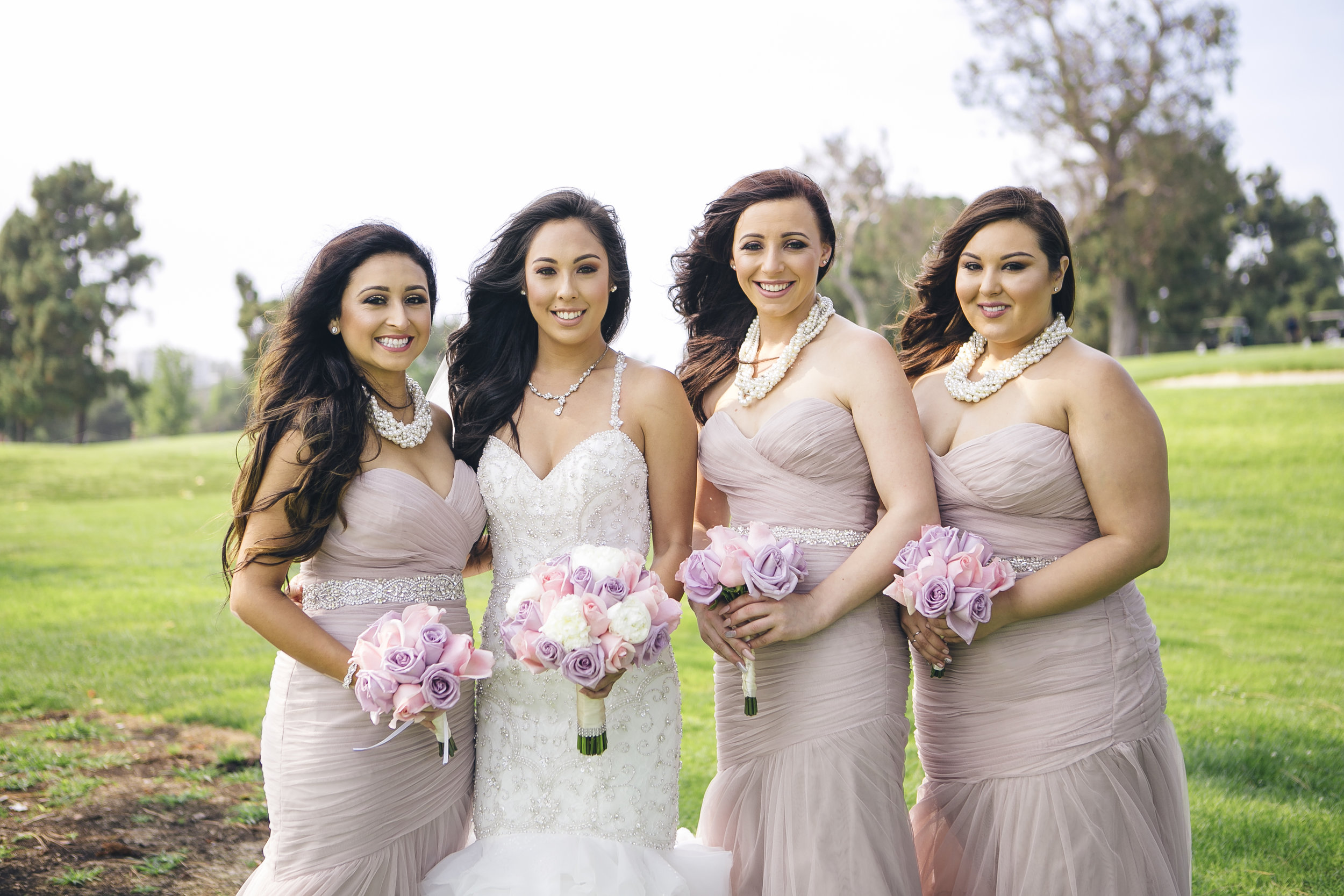 posh bridal party at summer wedding