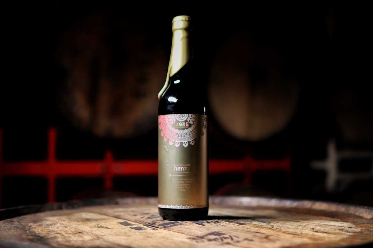 Barrel-Aged Henna: Double Rainbow (2018) - Released: 5/19/201814.3% ABVImperial Chocolate//Vanilla//Strawberry Stout aged in a blend of bourbon whiskey barrels. 14.3% ABV