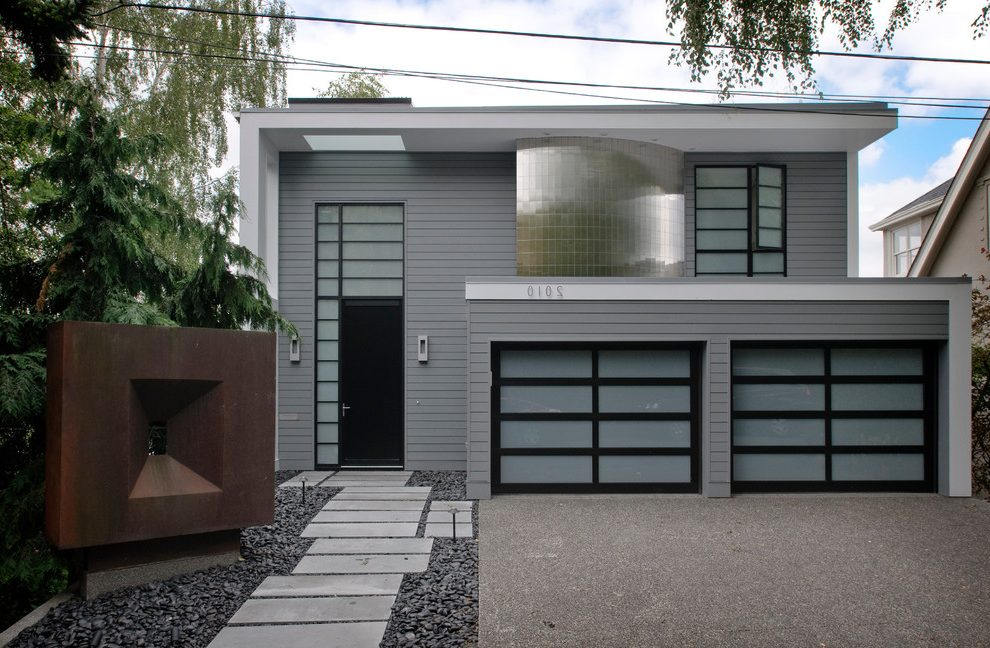 Gray-and-black-exterior-contemporary-with-translucent-glass-garage-door-house-numbers-copper-sculpture.jpg