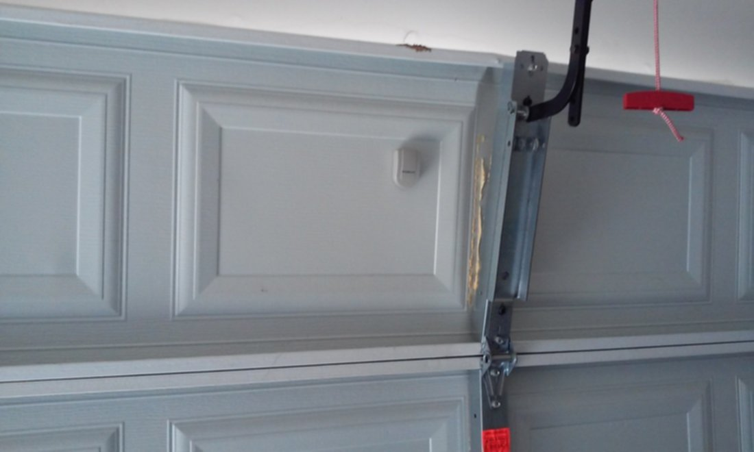 Garage door opener arm. A common repair. If your arm pulls away from the top section, you may have locked the door, or door has became caught on something during motion. Call us today for this repair. We can fix it.