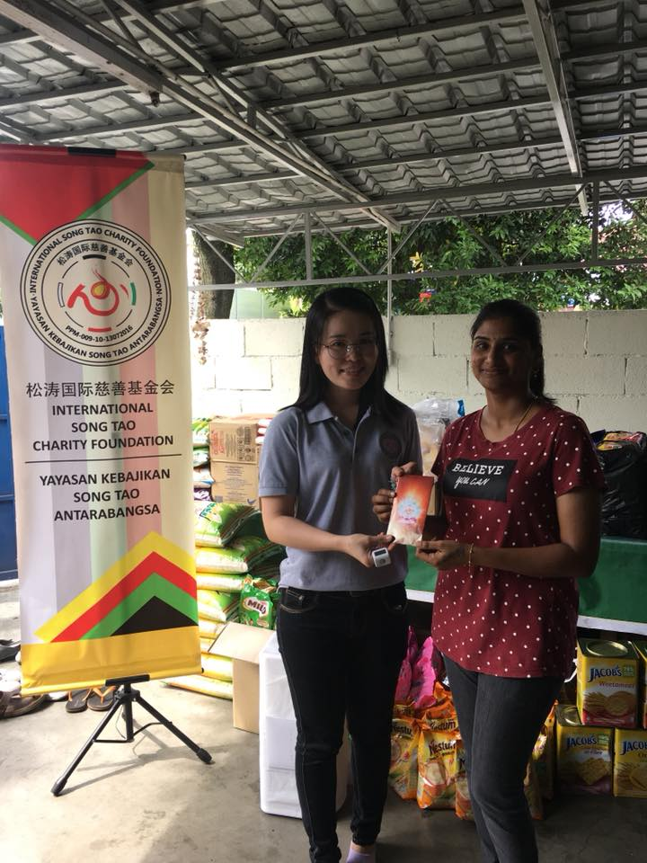 Our Activities Accountant, Ms. Tan Li Ting handing over the monetary fund from all kind donors to the representative of Thangam Illam Welfare Society.