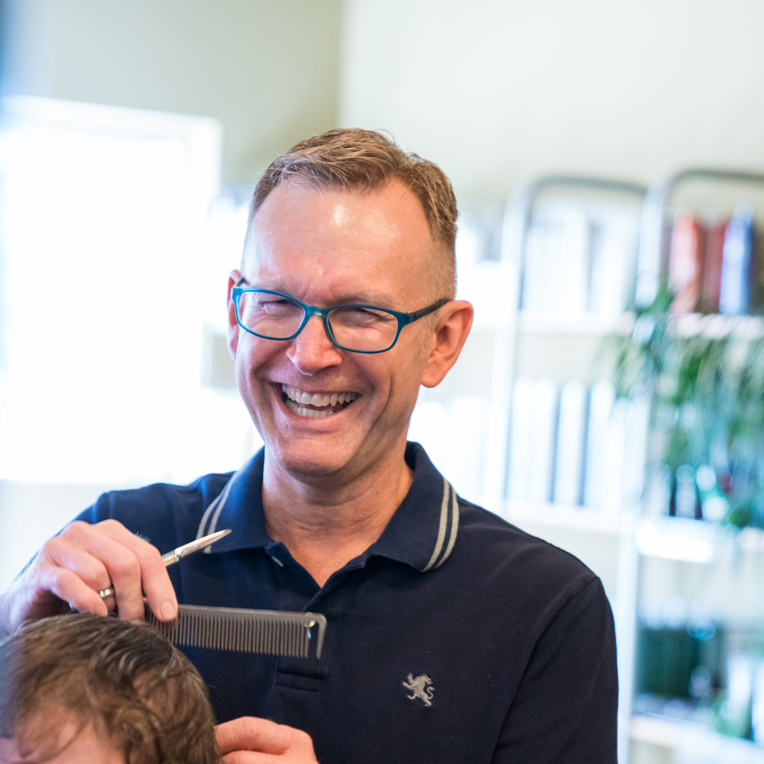 Greg Harman  Owner/Stylist  Through my work, I watch spirits lift as the people who sit in my chair see  what I see  in the mirror - something beautiful. Something positive. Something possible.  My clientele is very special to me. Many of them I have known and worked with for years... and their children...and their  children's  children. I'm quite proud of the work I've done, and I cherish the relationships I have made.  In 2003, I opened The Laura Gregory Salon with my friend of over two decades, Laura Puhl. I couldn't be more proud of this space and the atmosphere we have created together.