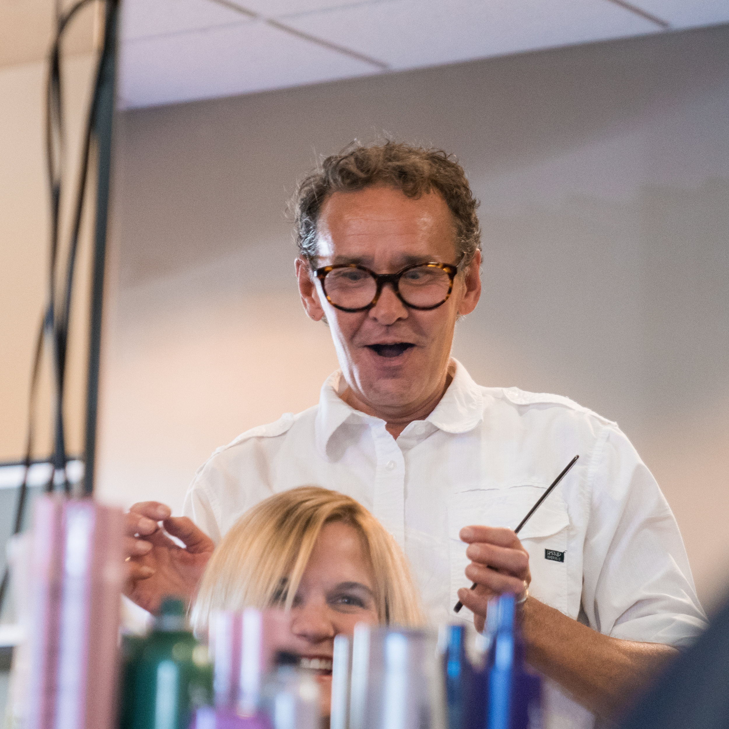 "Jon McGhee  Stylist  After giving his first haircut at seven years old, Jon was on his way to a career is the industry. He attended Cosmetology school after high school and had advanced training in London and Pittsburgh. With a career spanning over 35 years, his experience and training is vast. He has seen many trends come and go, but still looks forward to coming to the salon. He has been a member of The Laura Gregory Salon team since its inception. Jon is our ""social director."" No matter whose chair you are in, chances are Jon will come by and say hello."