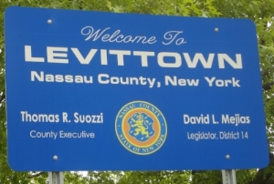 Levittown, named after its builder Levitt & Sons, Inc., was developed between 1947 and 1951 with backing from the Federal Housing Administration. This first and largest mass-produced suburb prohibited lease or sales to non-white residents.