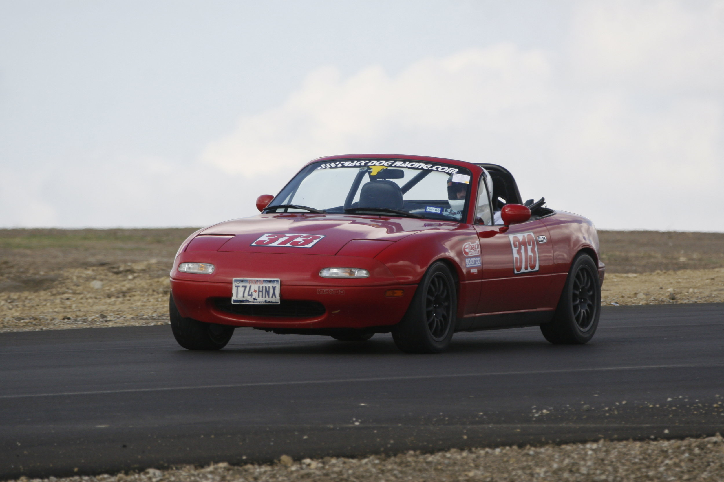 Miata 3 qtr view w-clouds.jpg