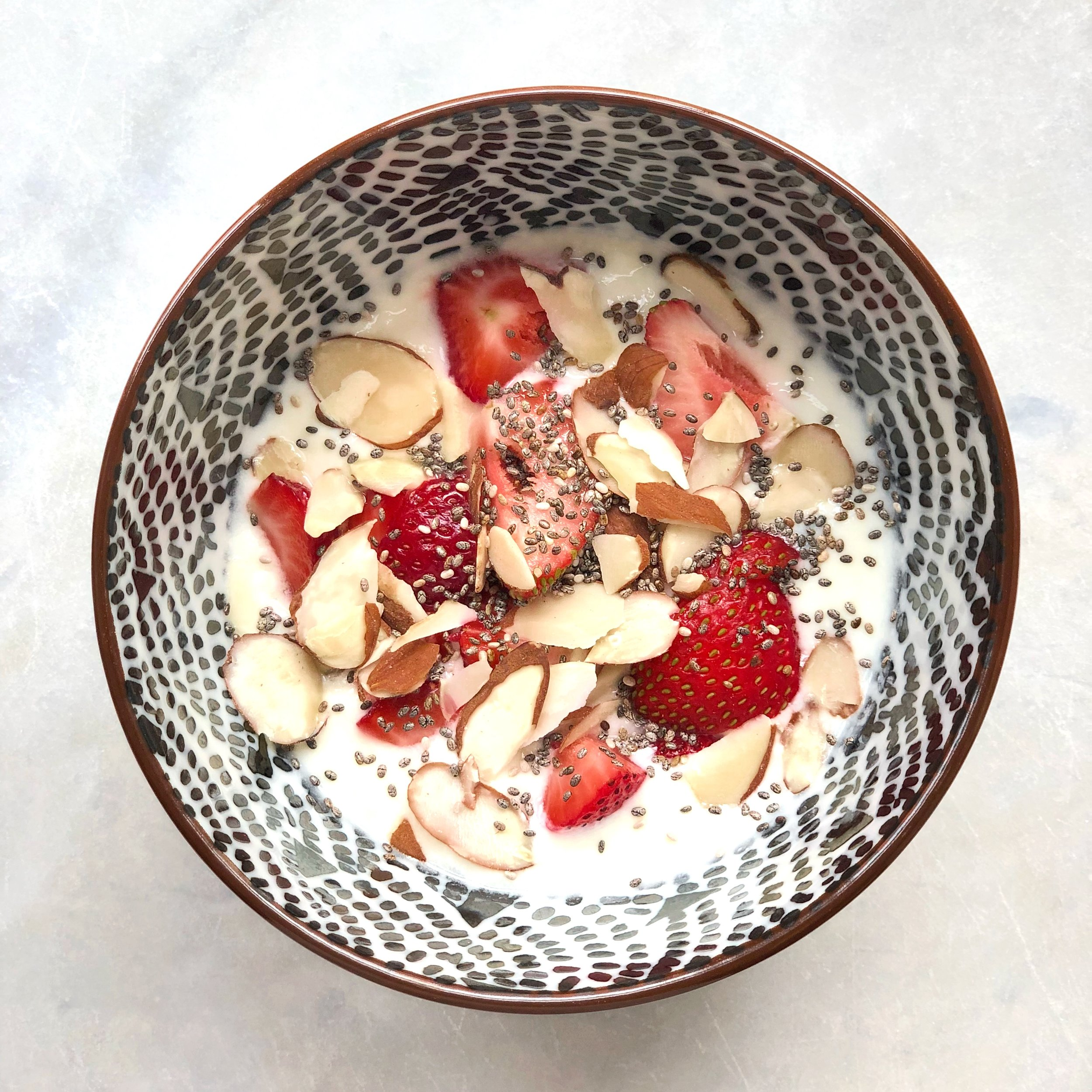 One of my fave mid-afternoon snacks is half a cup of plain, grass-fed yoghurt topped with sliced strawberries, slivered almonds and a tablespoon of chia seeds for extra protein and Omega 3s.