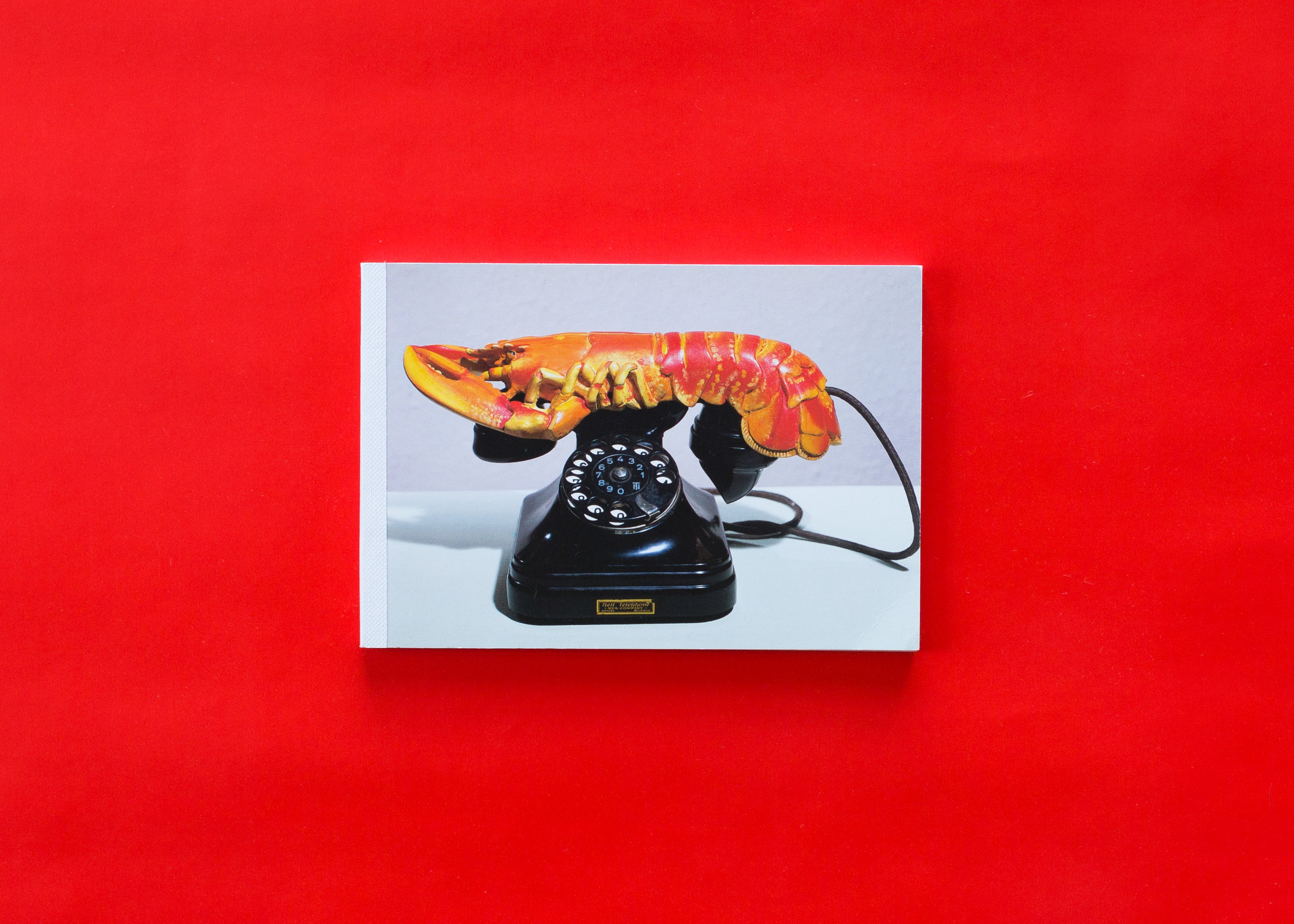 Notebook with Dali's Lobster Telephone image on cover.