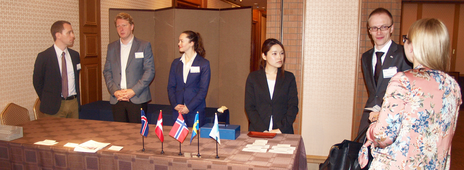 The reception desk for the five Nordic Chambers. From left: ISCCJ Executive Director Halldor Olafsson, SCCJ General Manager Martin Koos, NCCJ Executive Anette Yamamoto-Hansen, Natsuko Kunnas and new FCCJ Executive Director Antti Kunnas.