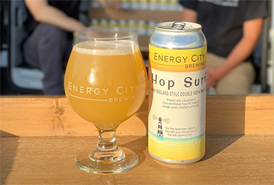 Hop Surf - Our creamy New England-Style Double IPAFresh batch of Hop Surf being canned just in time for your Labor Day Weekend! Citra and mosaic hops for notes of orange, peach, blueberry and pine with creamy texture and mild bitterness. First drops start today. NEDIPA 8.5% ABV.