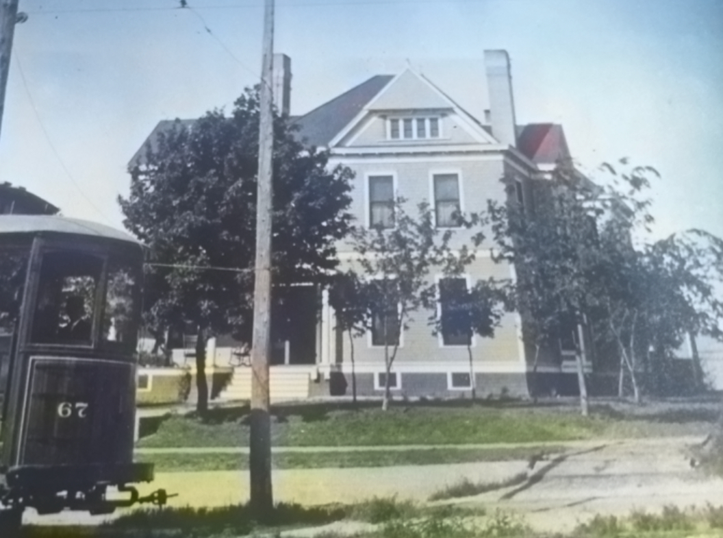 Colorization of a historic photo of the Brown-Tuck Mansion revealed the original color scheme of Gray, White, & Black.
