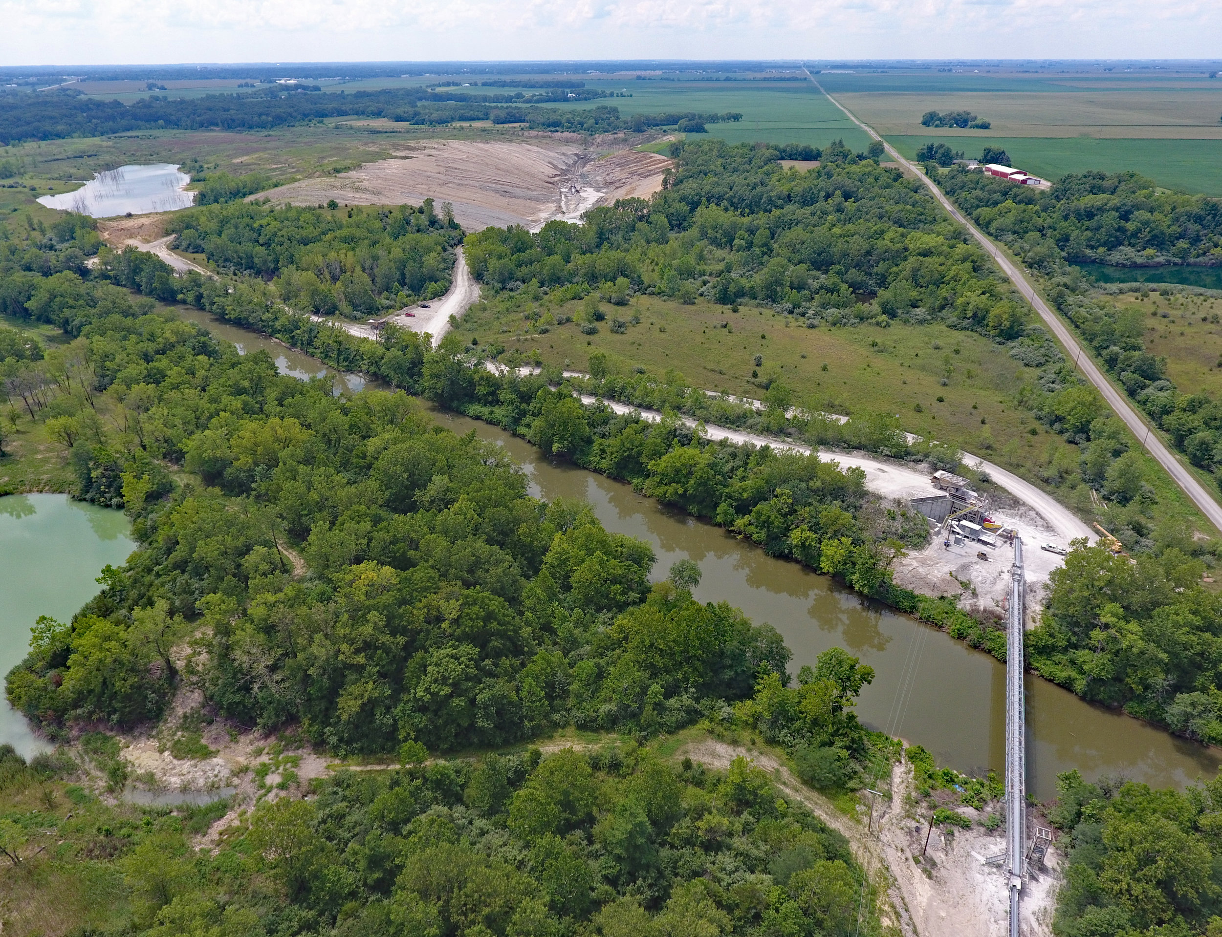 Overview of river conveyor, portable plant site, and west pit. June 2017.