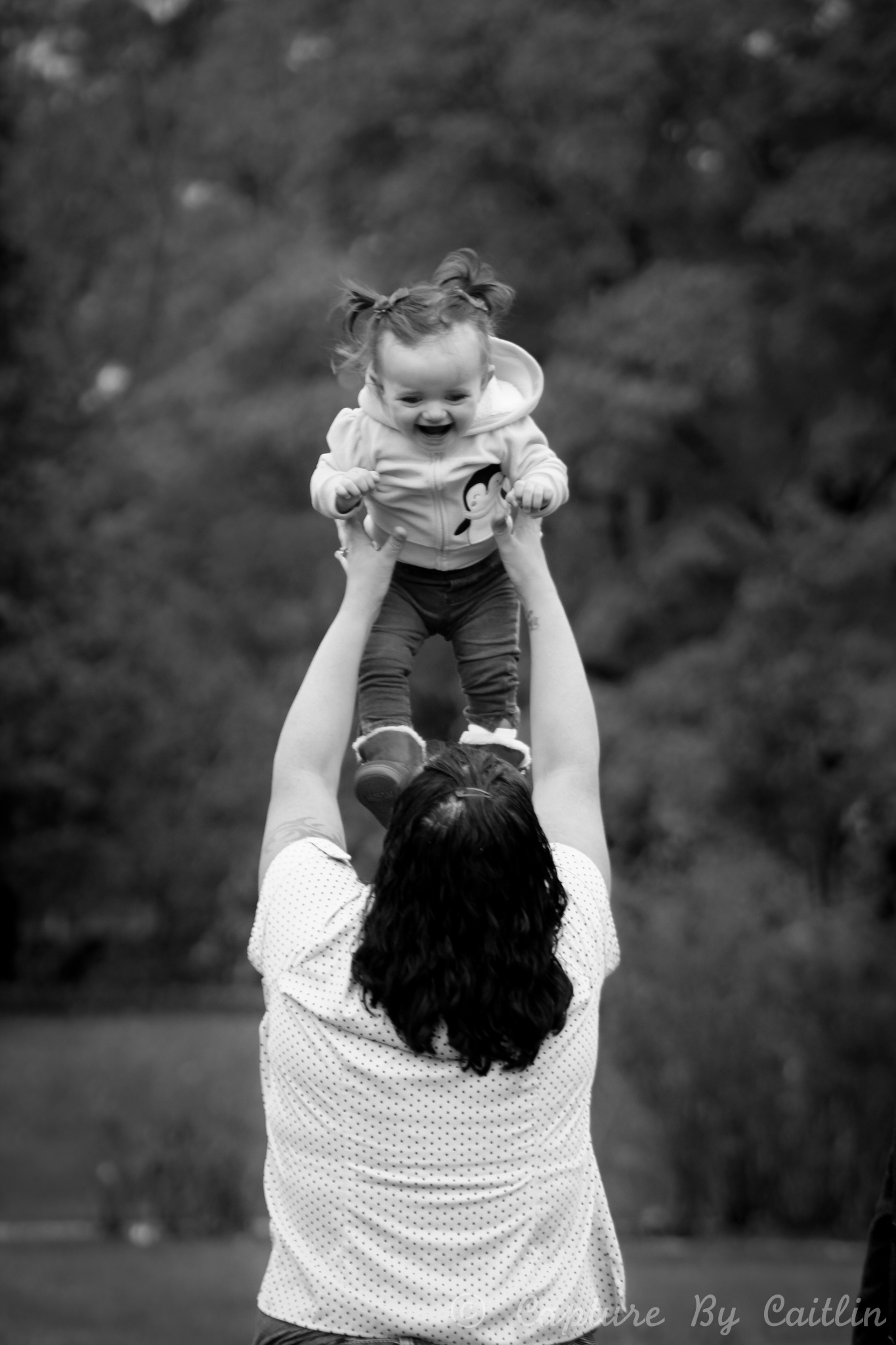 """""""Everyone, I cannot recommend Capture By Caitlin enough. She has done such a phenomenal job with all of our family events and has the eye and patience to assure that moments like these are captured forever. Thank you for being awesome Caitlin ♡ and thank you for this pic of my flying little love"""" - - Krissy Niedziolka, 2018"""