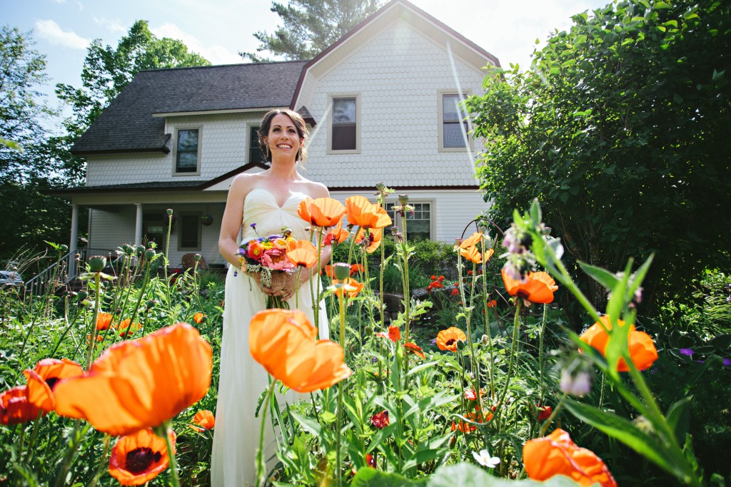 Bride in field of flowers
