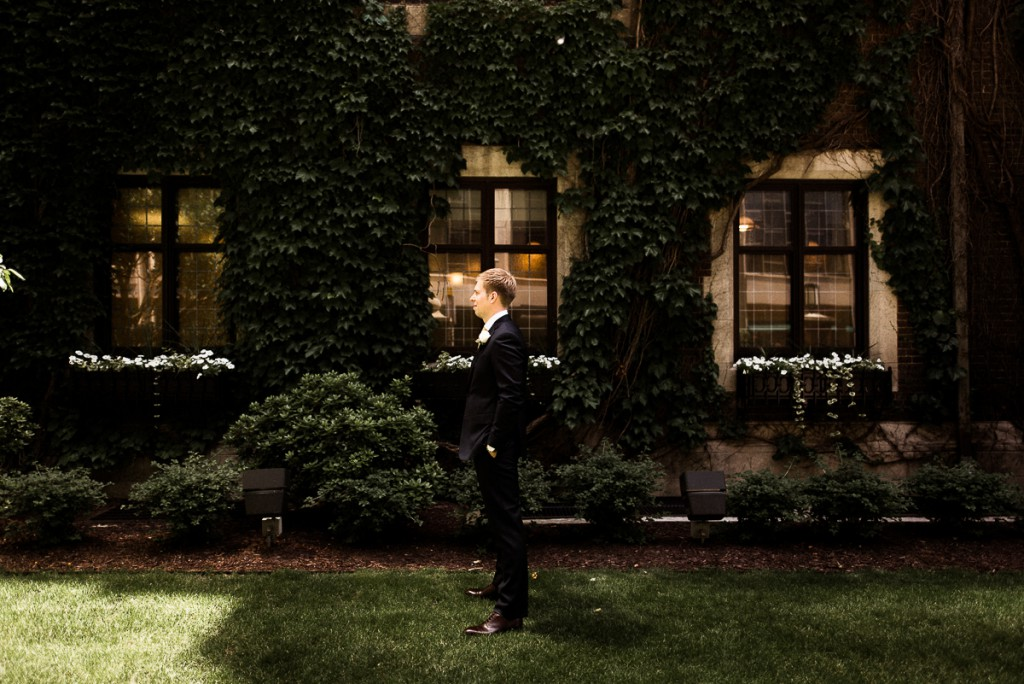 Groom awaiting bride for first look outside the Minneapolis club