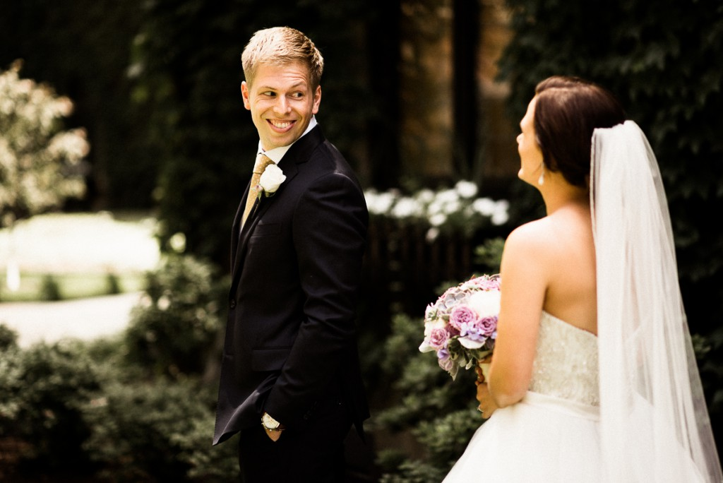 groom's expression seeing bride for first time after first look at the Minneapolis club