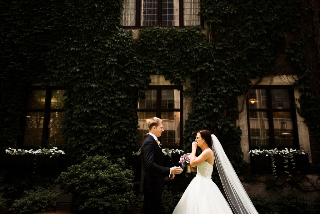 bride and groom pose for portrait outside of the Minneapolis club