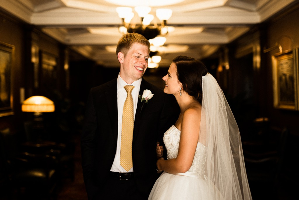 Bride and groom pose for couple's portrait inside the Minneapolis club
