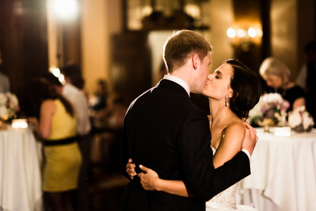 Bride and groom kissing on the dance floor during reception at Minneapolis Clube