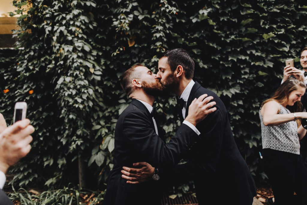 First kiss, same-sex outdoor wedding ceremony in Linden Hills Minnesota