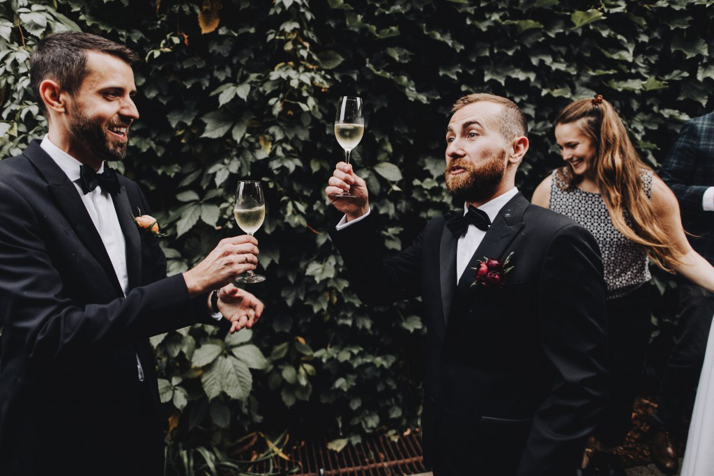 Celebratory champagne toast following wedding ceremony at Tilia in Linden Hills, Minnesota
