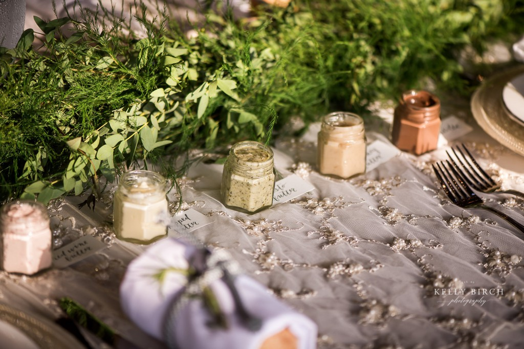 variety of spreads for bread at each table for wedding reception, family style dining