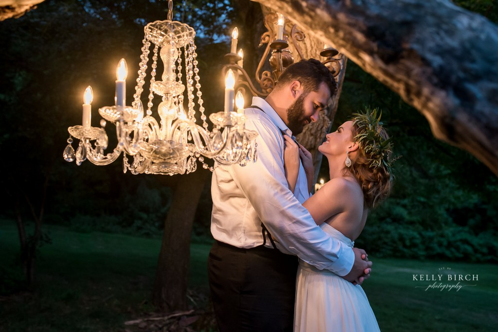 Bride and groom at night, Historic Hope Glen Farm, ceremony alter with chandelier
