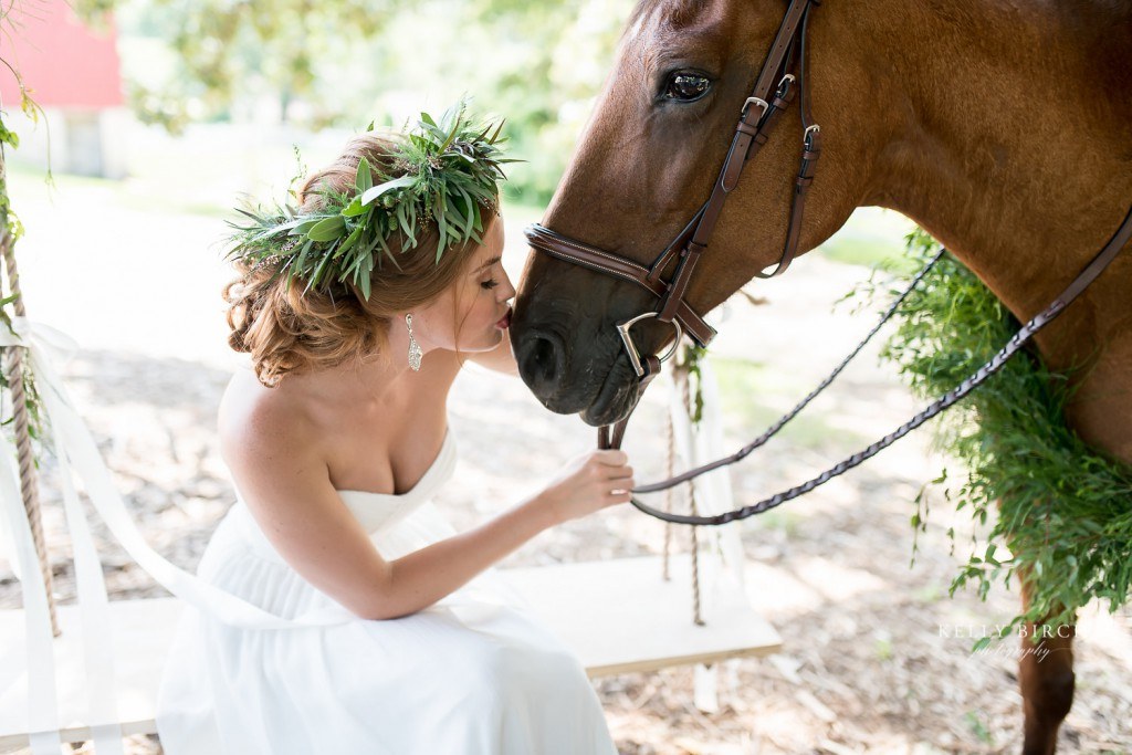 Bride kissing horse