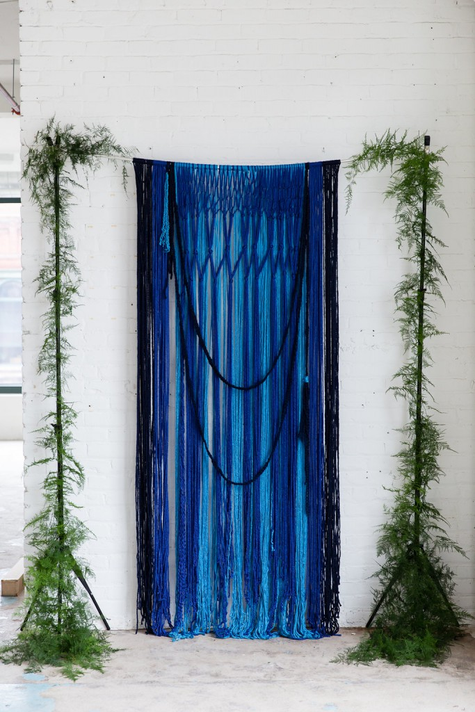 Creative ceremony backdrop made with yarn and greenery, as seen in Dainty Obsessions