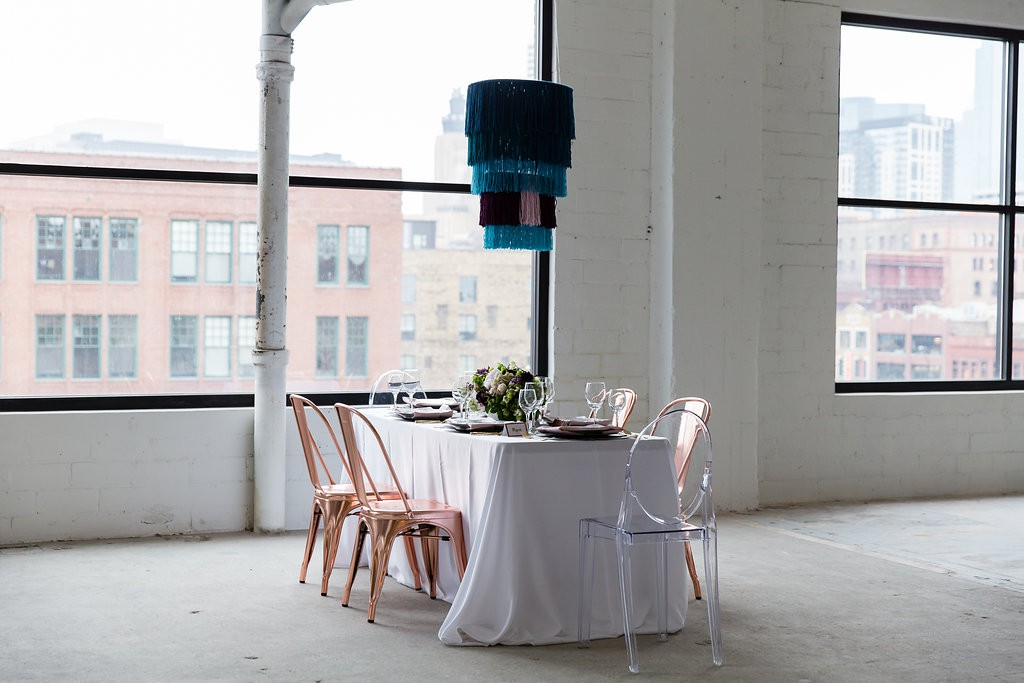 Modern, colorful table setting for wedding reception